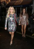 Tallia Storm wears a silver dress during a night out at Kadie's Cocktail Bar & Club in London