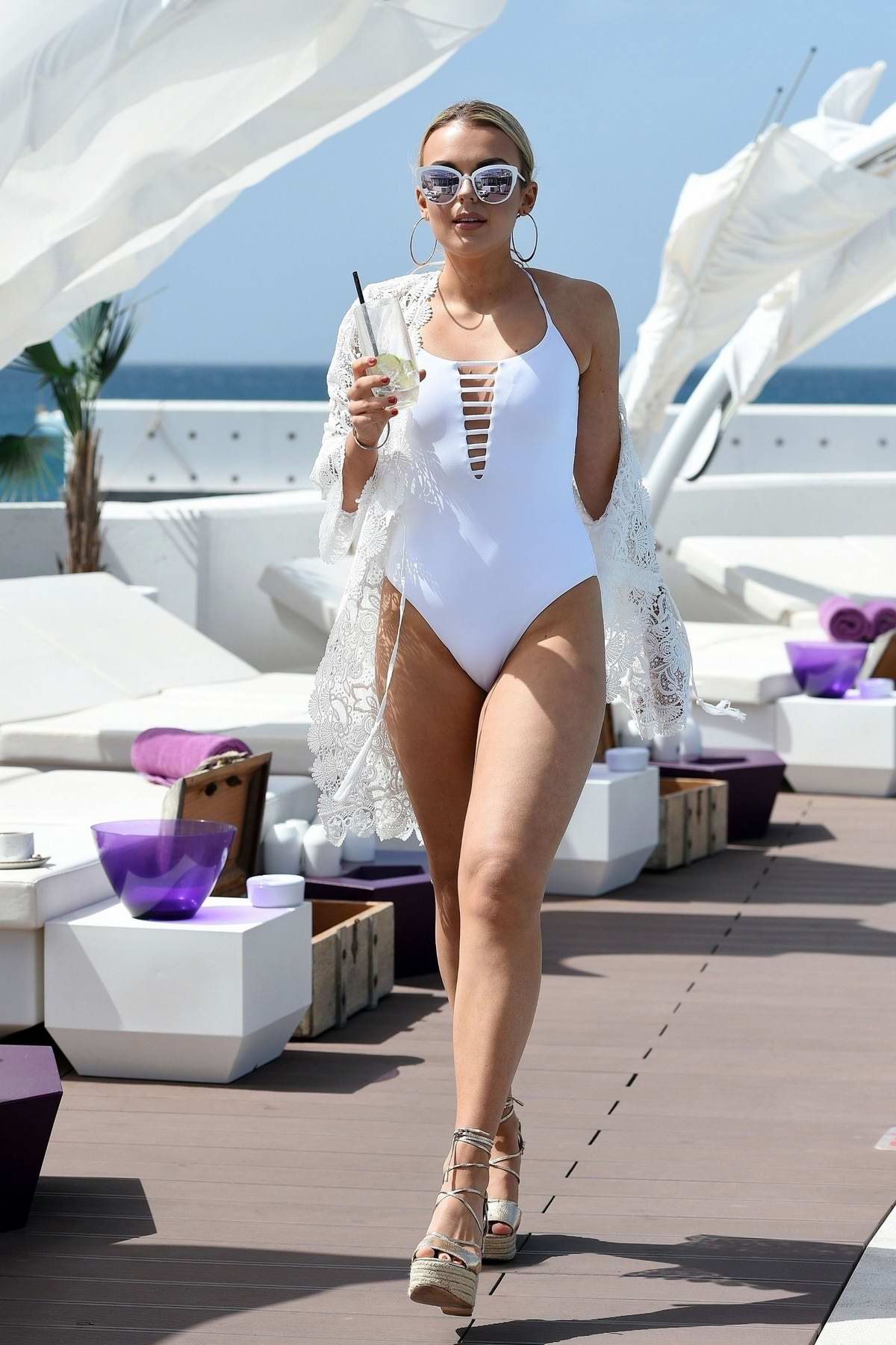Tallia Storm wears a white swimsuit at the 'Celebs Go Dating' pool party in Cape Verde