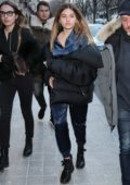 Thylane Blondeau wears a navy blue jumpsuit with a black quilted jacket as she leaves the Royal Monceau Hotel in Paris, France