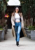 Victoria Justice keeps it chic in a leopard print trench coat and jeans while out with a friend in New York City