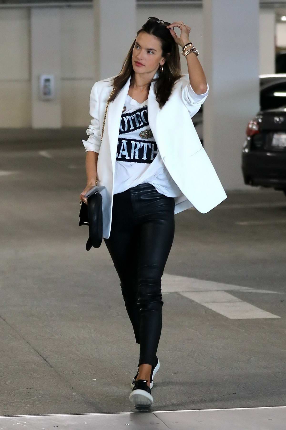 Alessandra Ambrosio looks stylish in a white blazer and black leather pants as she grabs lunch with a friend at Eataly in Los Angeles
