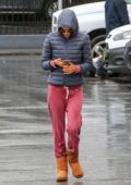 Alessandra Ambrosio out in the rain wearing a hooded jacket in Los Angeles