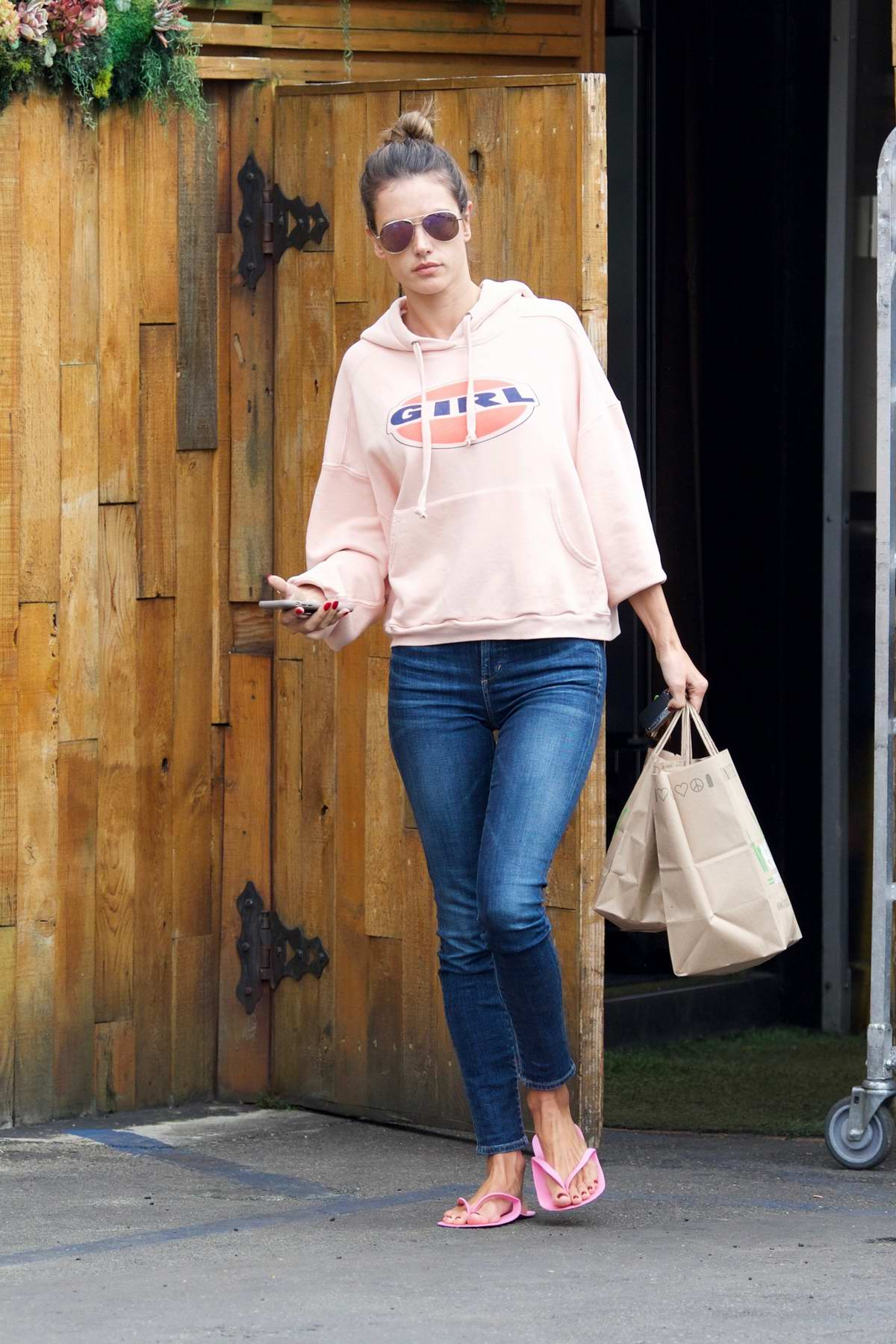 Alessandra Ambrosio spends some time at a nail salon before stopping at Kreation Organic in Los Angeles