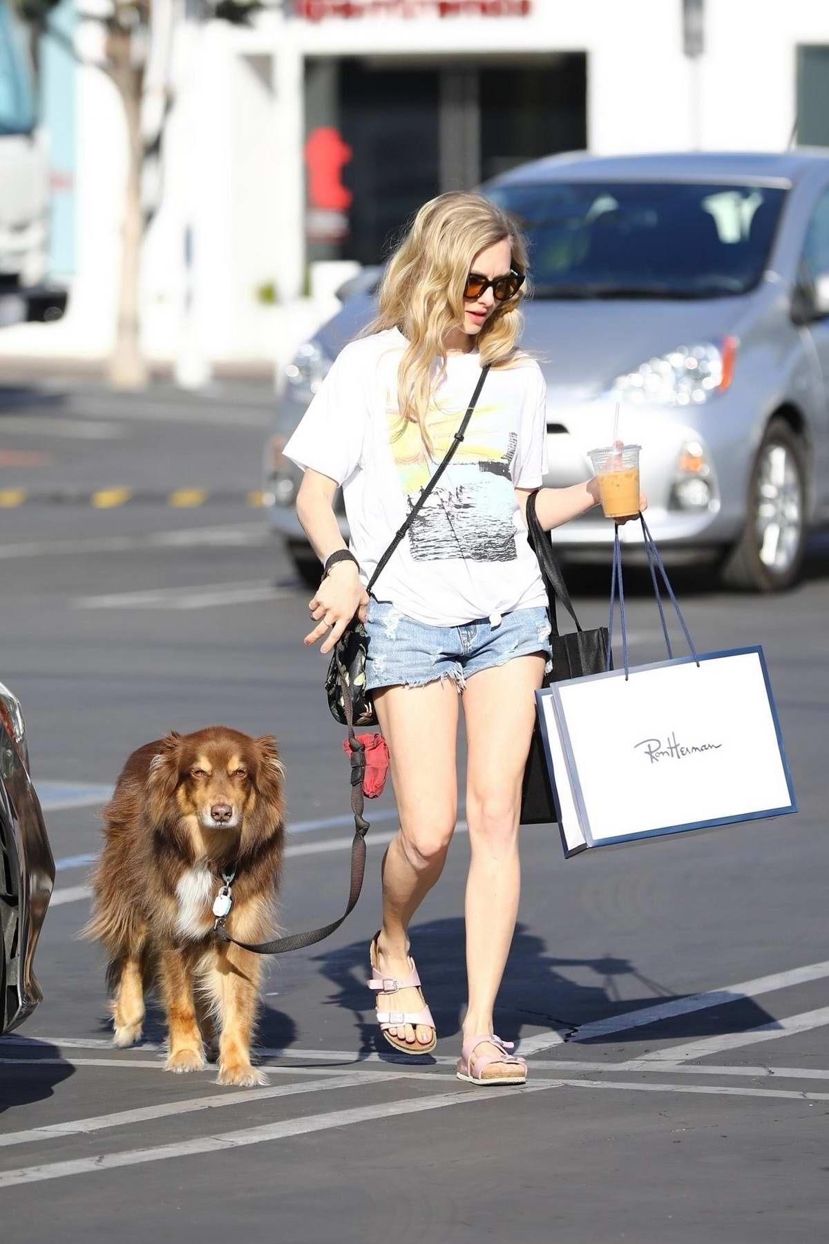 Amanda Seyfried spotted in denim short and white top as she leaves Fred Segal with her dog in Los Angeles