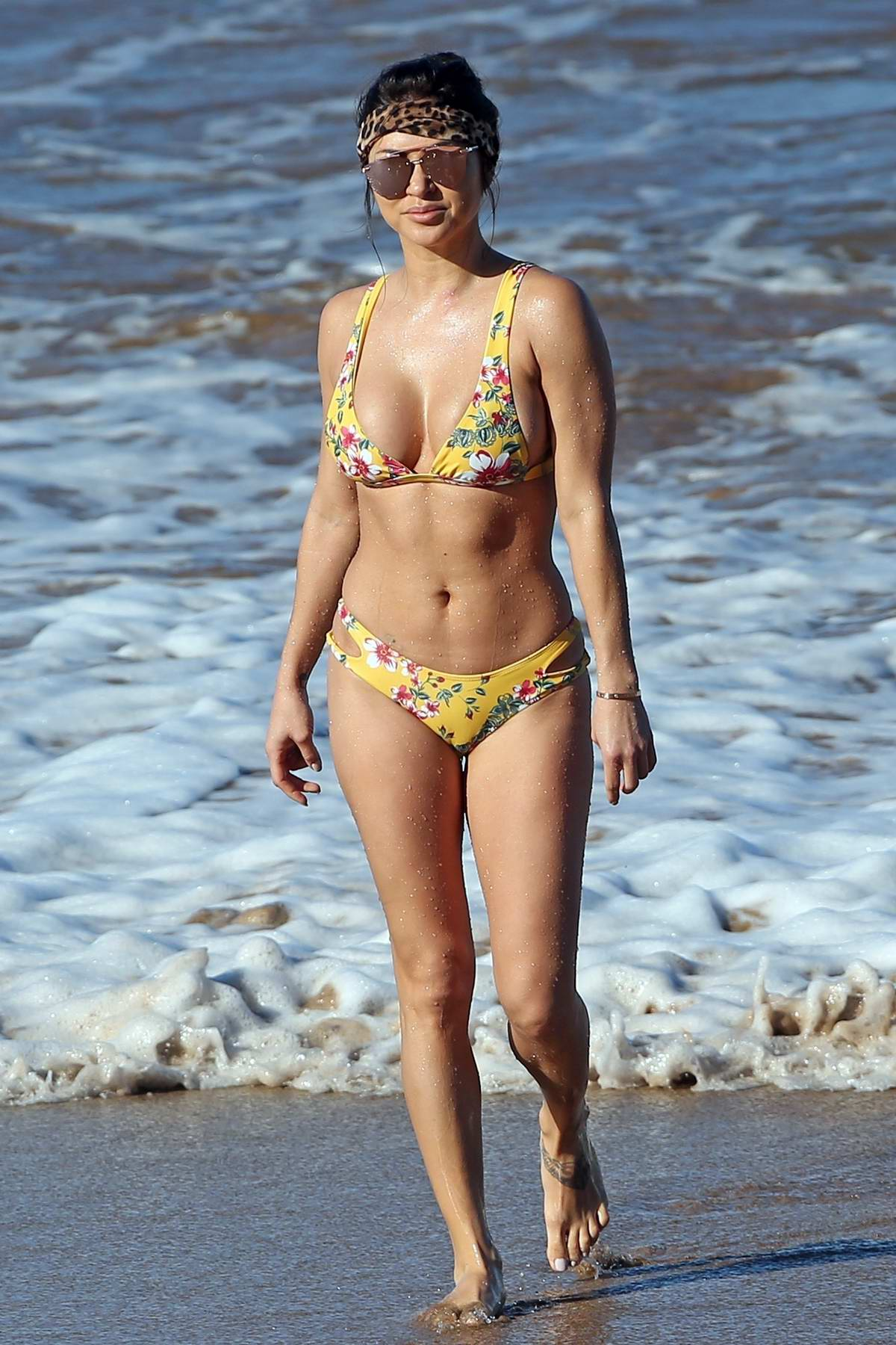 Arianny Celeste enjoys the ocean in a yellow floral print bikini while on vacation in Maui, Hawaii