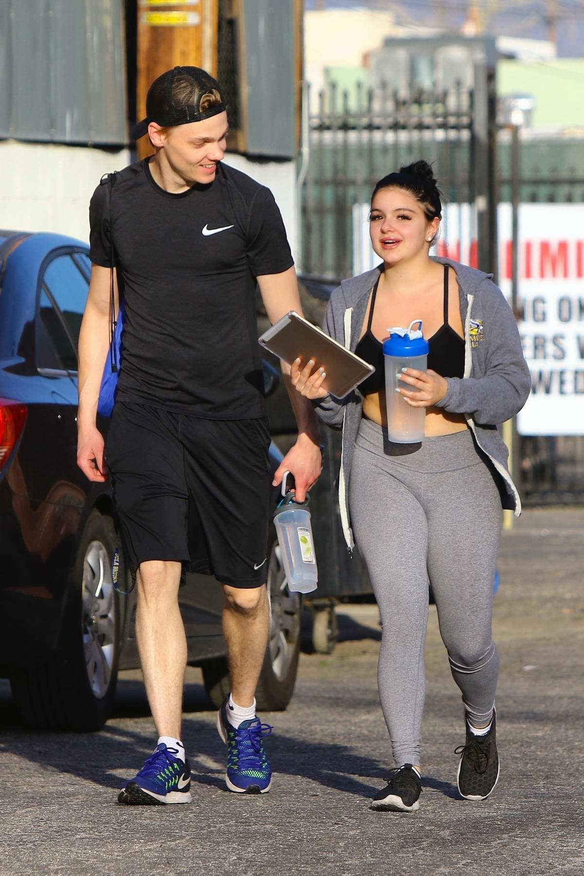 Ariel Winter wears a black sports bra and grey leggings with matching jacket as she leaves her gym in Los Angeles