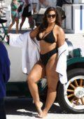 Ashley Graham poses in a black bikini on the beach during a photoshoot in Miami, Florida - Set 01