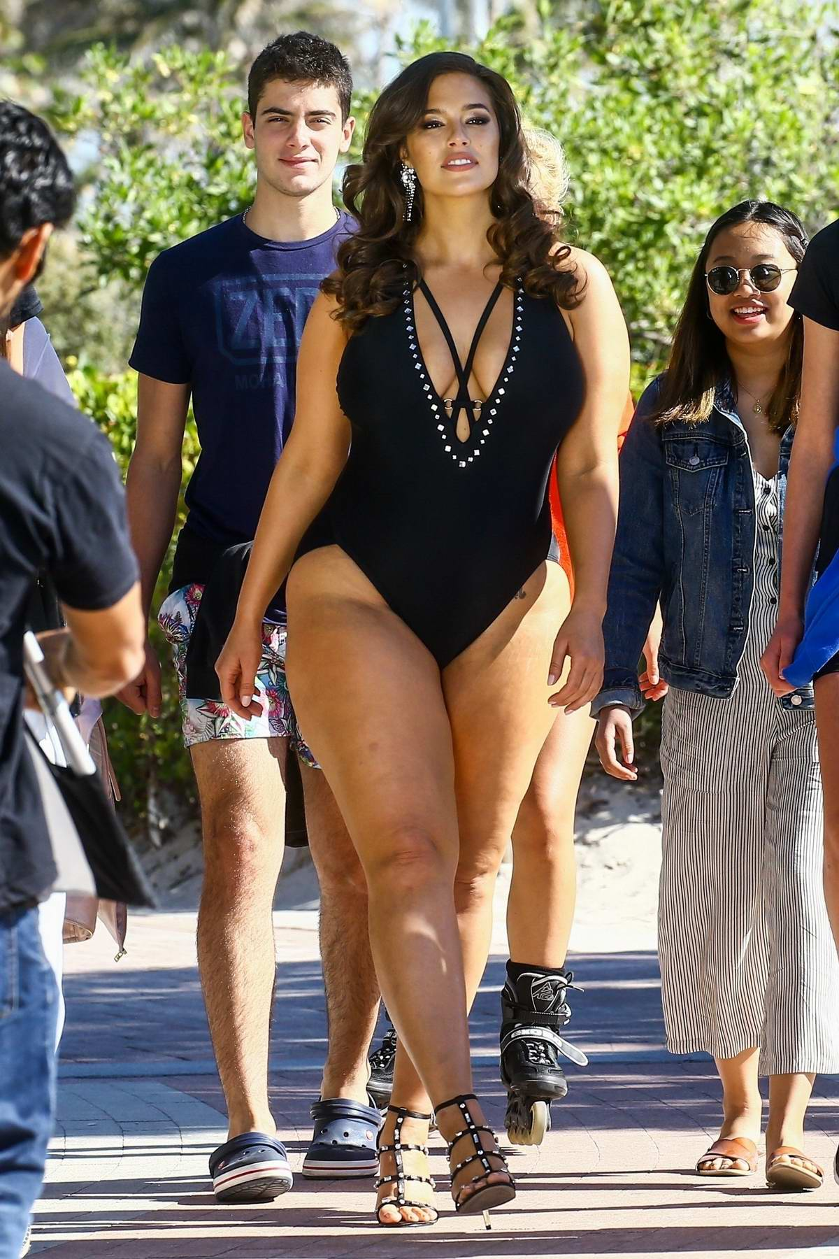 Ashley Graham Wears A Black Swimsuit On The Beach During A