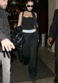 Bella Hadid dons an all black ensemble as she leaves her hotel in Paris, France