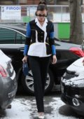 Bella Hadid steps out in a in a blue, white and black color block blazer with black pants during Paris Fasion Week, France