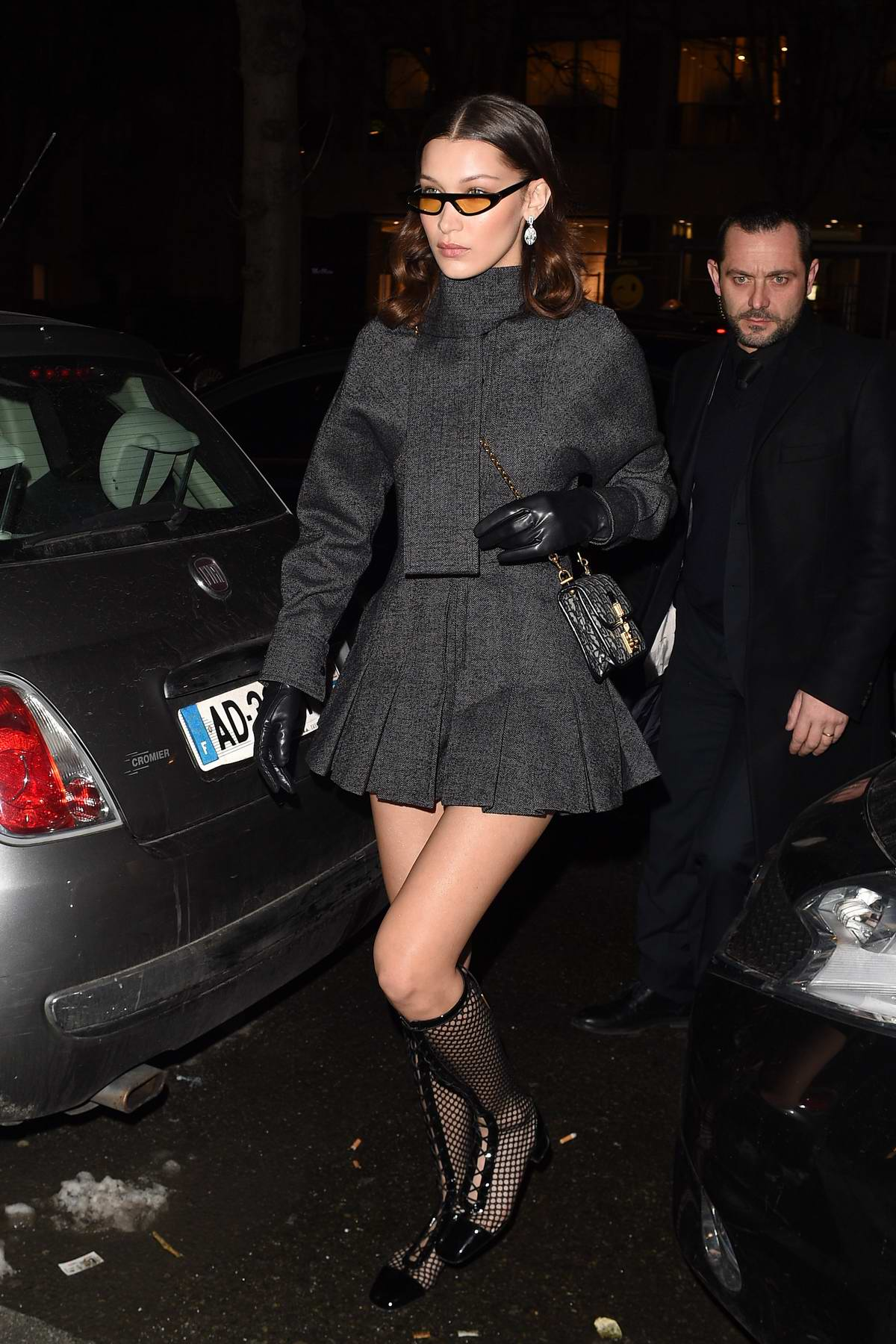 Bella Hadid wearing a grey short dress while leaving the Royal Monceau Hotel in Paris, France