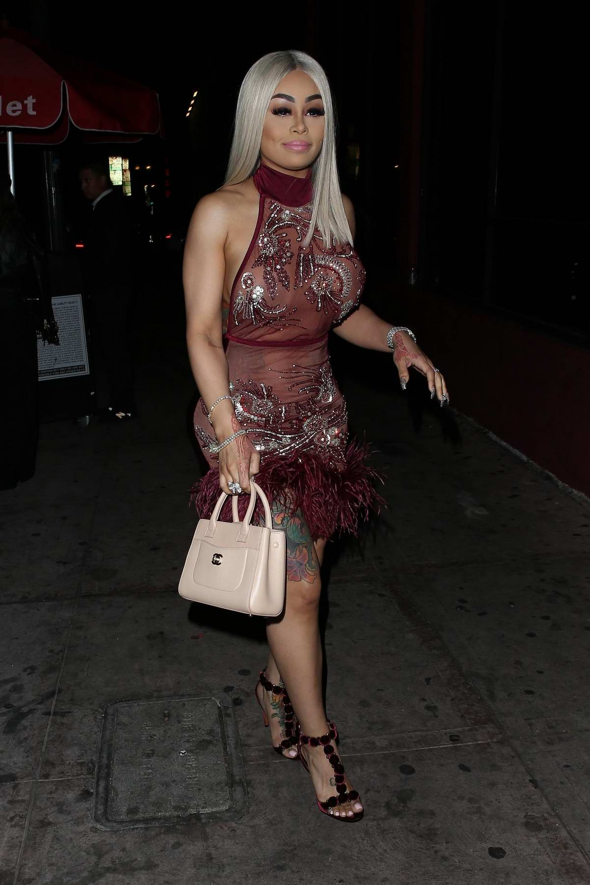 Blac Chyna wears a sheer red dress while out to dinner during a night out in Beverly Hills, Los Angeles