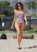 Blanca Blanco wearing a Disney-themed swimsuit at beach in Malibu, California
