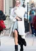 Candice Swanepoel looks stunning in a white fur coat while out for walk in New York City
