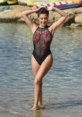 Chloe Goodman wears a sheer swimsuit on the beach while on holiday in Cyprus
