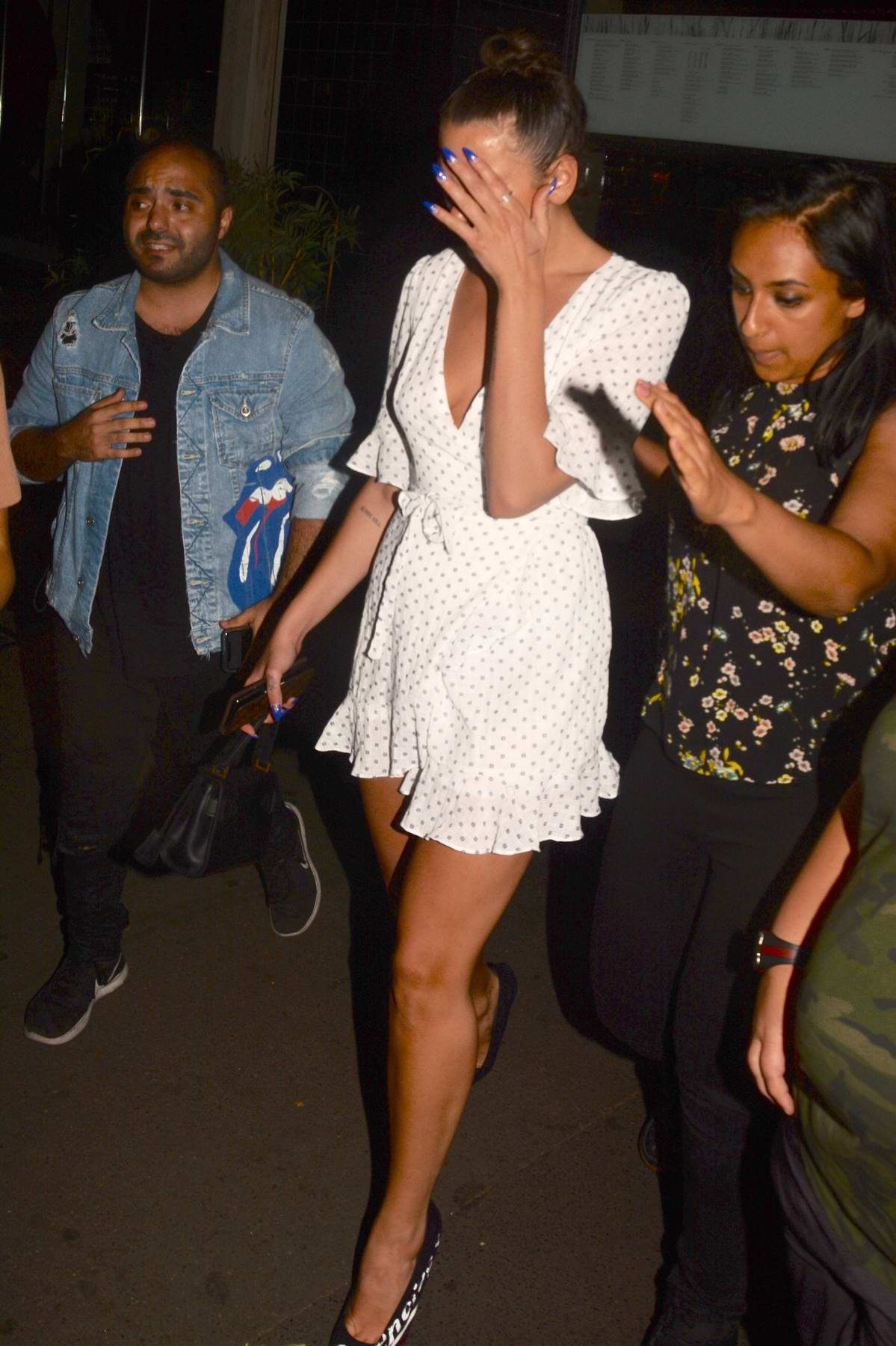 Dua Lipa covers her swollen mouth while leaving dinner in Sydney, Australia
