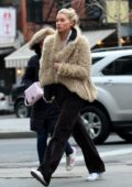 Elsa Hosk wears a fur jacket while out and about in Soho, New York City