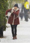 Emilia Clarke rocks stylish shearling jacket as she braves the harrowing British weather to run errands in London