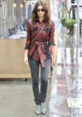 Emily Ratajkowski looks stylish in a brown leather jacket, black jeans and checkered heels as she leaves lunch on a rainy day in Beverly Hills, Los Angeles
