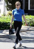 Emma Roberts wears a blue blouse and black jeans while out in Beverly Hills, Los Angeles