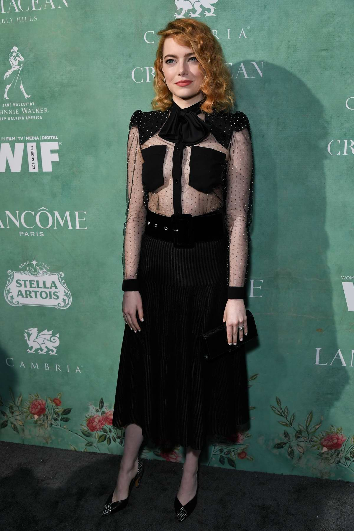 Emma Stone attends the 11th Annual Women In Film Pre-Oscar Cocktail Party at Crustacean in Beverly Hills, Los Angeles