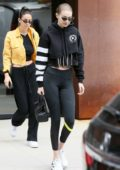 Gigi Hadid dons an all black outfit with a Versace bag as she heads out in New York City