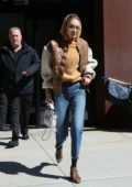 Gigi Hadid rocks a jacket over a hoodie with cropped jeans and leopard print boots while heading out in New York City