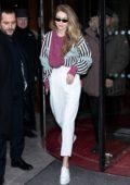 Gigi Hadid rocks a retro look as she leaves her hotel during Paris Fashion Week in Paris, France