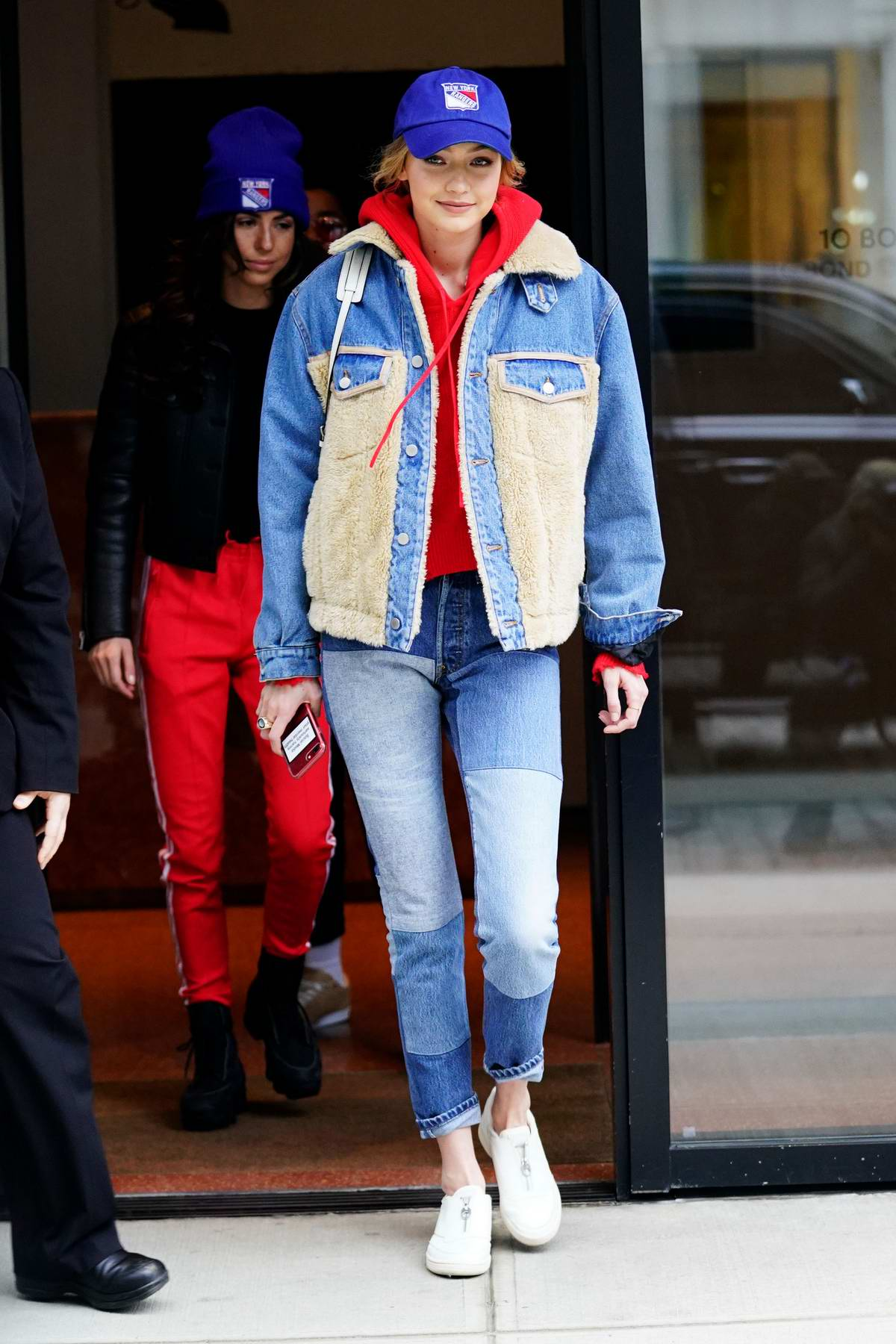 Gigi Hadid steps out in double denim with a New York Rangers hat as she heads out to the Rangers game in New York City
