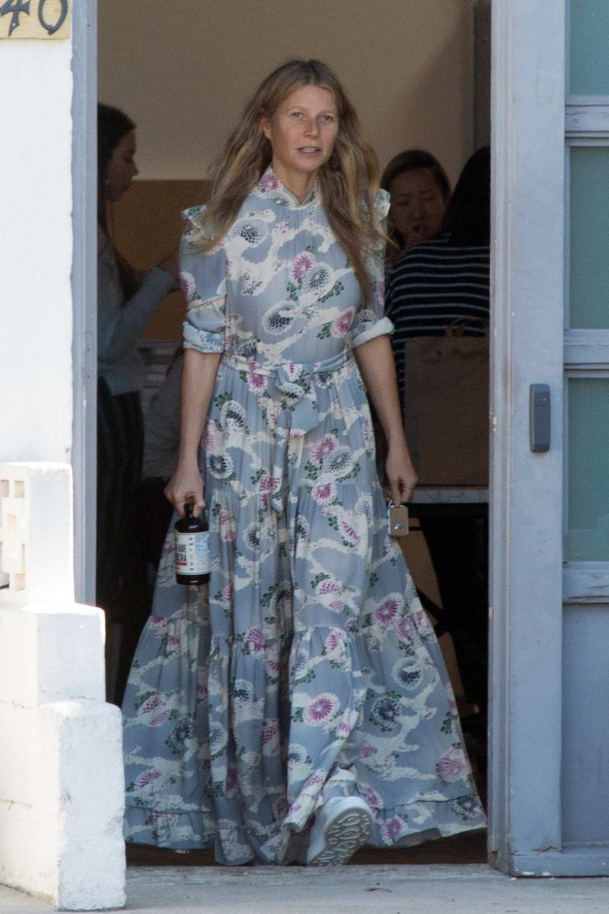 Gwyneth Paltrow steps out in a grey floral dress to grab a Kombucha in Los Angeles
