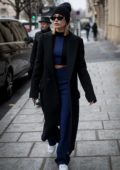 Hailey Baldwin looks chic in a black trench coat over a blue outfit as she leaves L´Avenue restaurant in Paris, France
