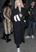 Hailey Baldwin wearing an Off-White coat and white boots to dinner at Craig's in West Hollywood, Los Angeles