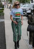 Hailey Baldwin wore a Gucci t-shirt tucked into green metallic drawstring pants with black boots while grabbing lunch at Zinque Restaurant in West Hollywood, Los Angeles