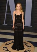 Halston Sage attends 2018 Vanity Fair Oscar Party at the Wallis Annenberg Center for the Performing Arts in Beverly Hills, Los Angeles