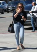 Hilary Duff applies some lip gloss on her way out after lunch in Beverly Hills, Los Angeles