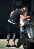 Hilary Duff hugs her trainer while she leaves after a workout session at the gym in Beverly Hills, Los Angeles