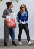 Isla Fisher wears a blue oriental print jacket as she stop to pick up a dress with her assistant in West Hollywood, Los Angeles