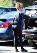 Julianne Hough puts her dogs back in the car boot after walking them in Studio City, Los Angeles