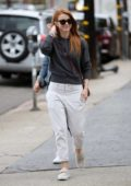 Julianne Hough steps out in a dark grey top and white khaki trousers while out shopping with her friends in West Hollywood, Los Angeles