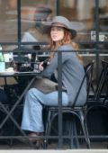 Julianne Hough wore flared jeans with a white patterned shirt and hat while enjoying lunch with a friend in Los Angeles