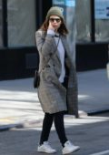 Kate Mara keeps warm in a plaid long coat with a beanie while out in New York City
