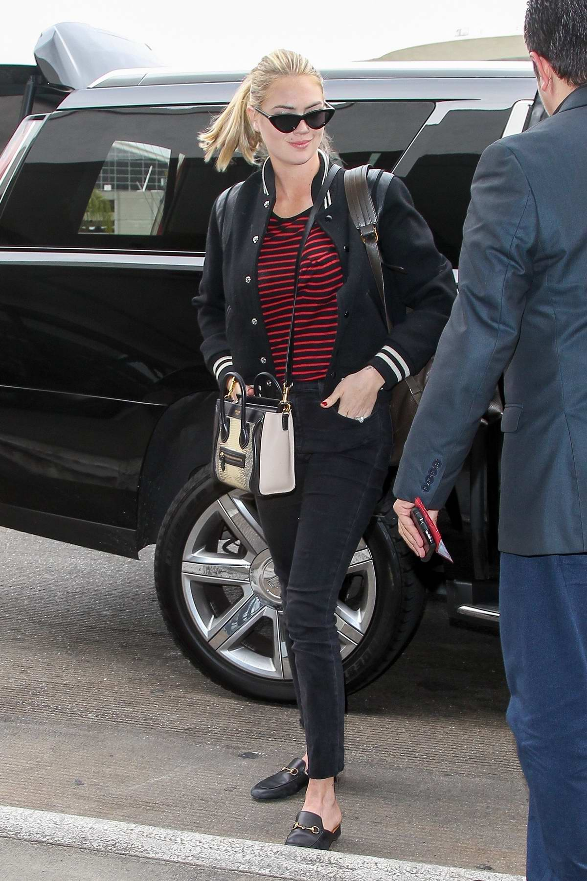 Kate Upton look stylish in a varsity jacket as she arrives to catch a flight at LAX airport, Los Angeles