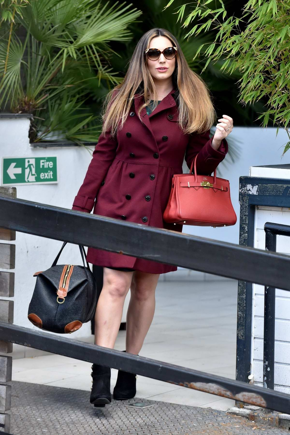 Kelly Brook spotted in a maroon coat while leaving the ITV Studios in London