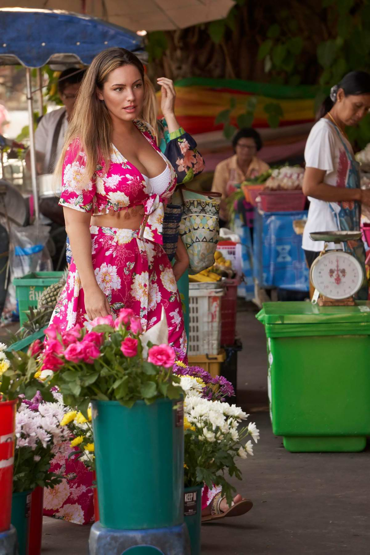 Kelly Brook wears a pink floral print dress while shopping fruits in Phuket, Thailand