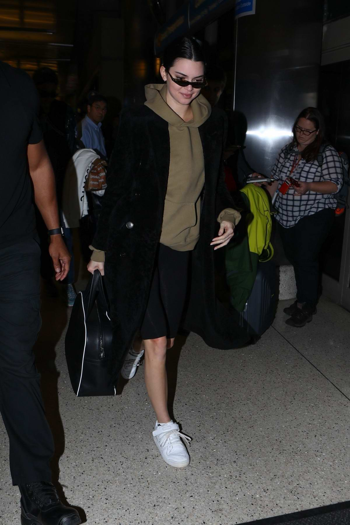 Kendall Jenner arrives at LAX airport to catch a flight to Paris