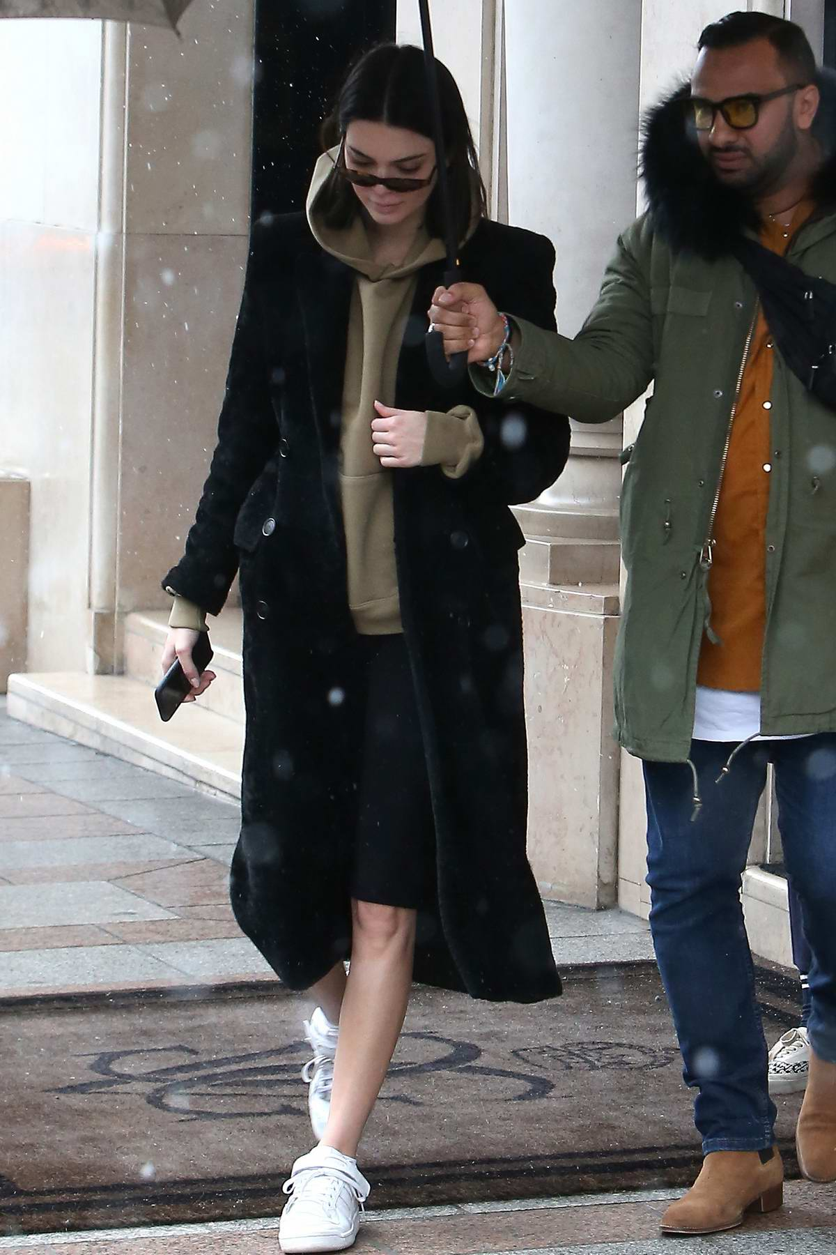 Kendall Jenner leaves her hotel in snowstorm as she heads for a photoshoot in Paris, France
