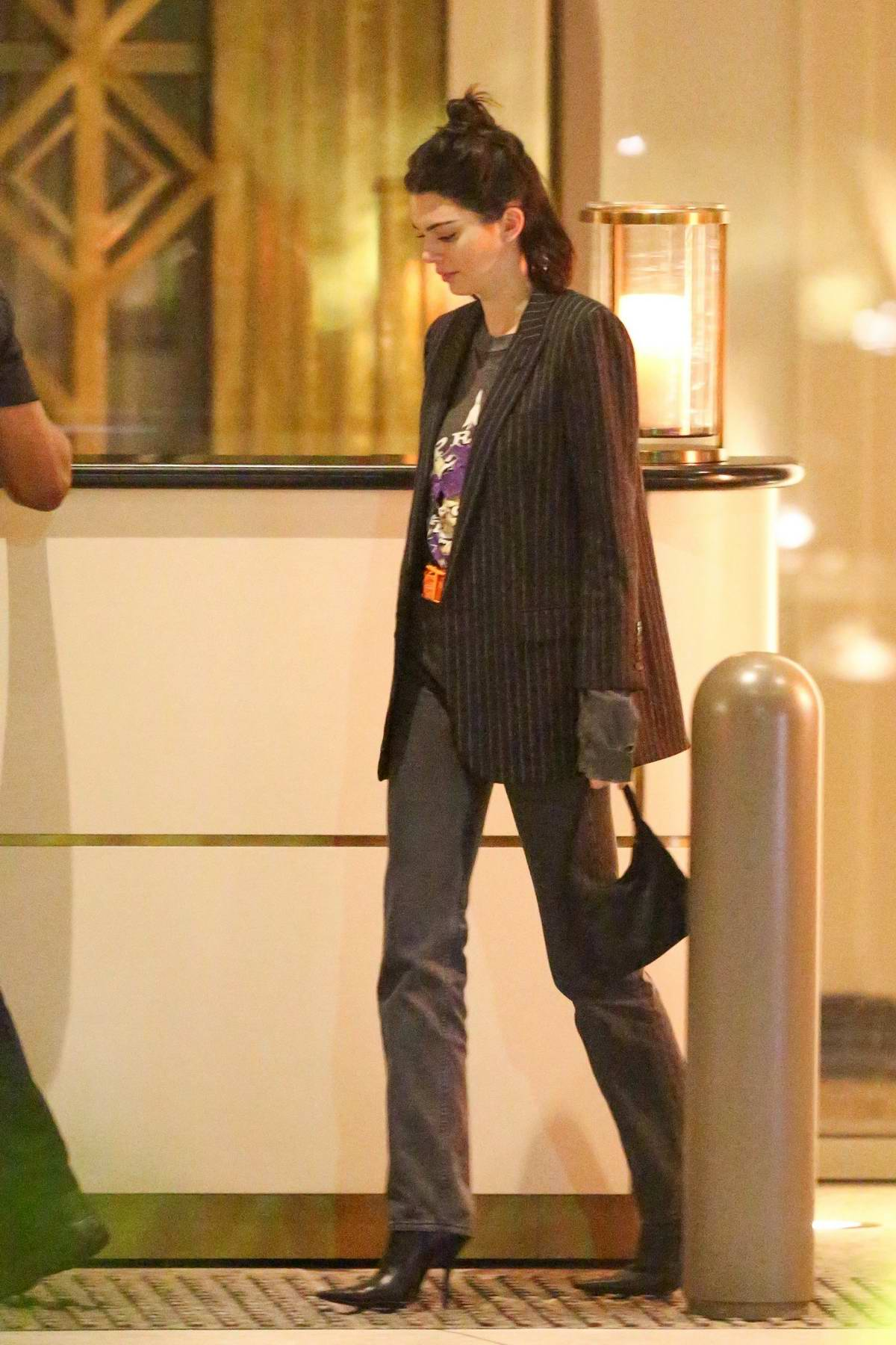 Kendall Jenner makes a quite exit from Waldorf Astoria Hotel in Beverly Hills, Los Angeles