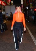 Kim Kardashian wears bright orange top during a night out in Tokyo, Japan