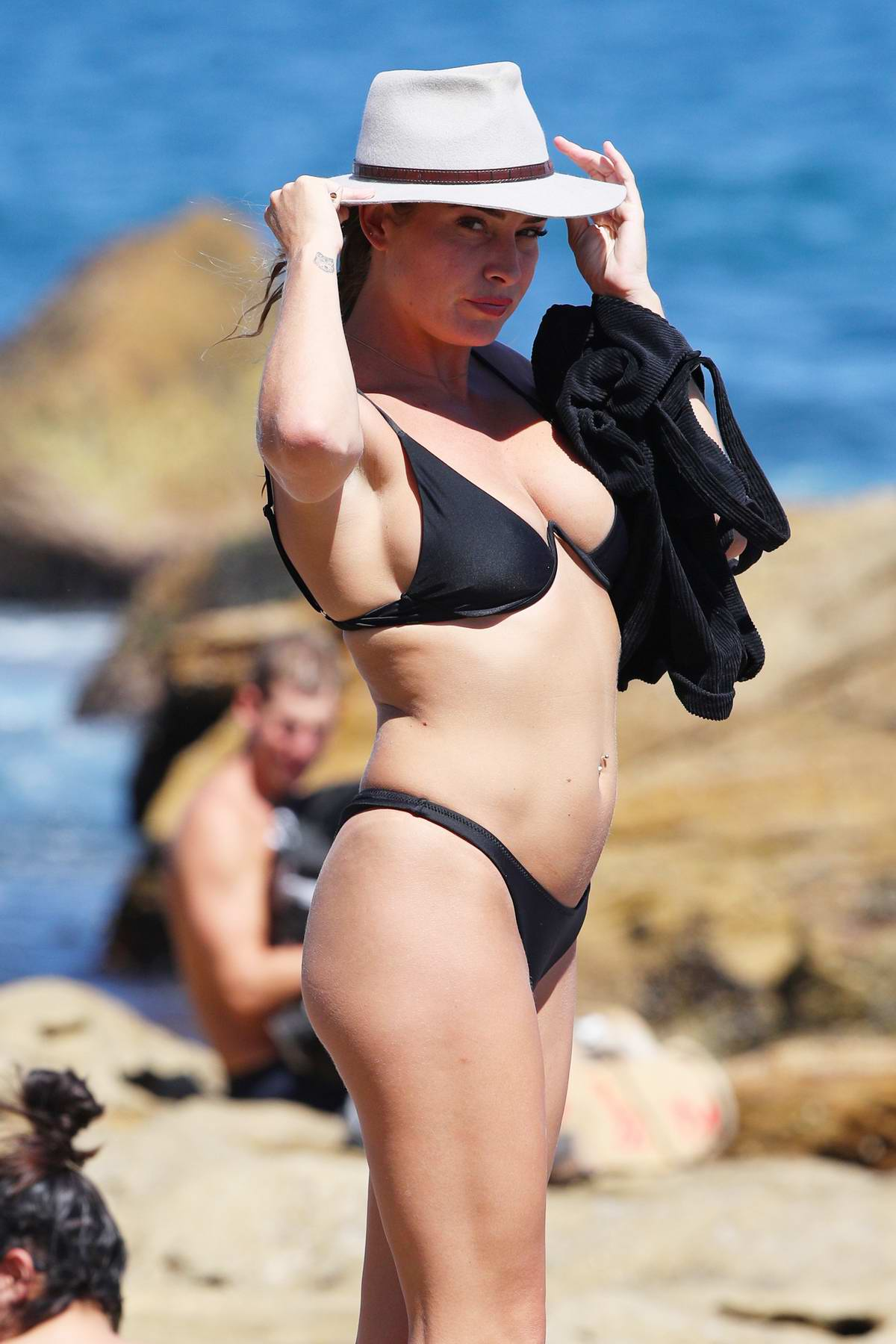 Lisa Clark cools off in a black bikini at Bondi beach in Sydney, Australia