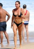 Lisa Clark goes for swim in black bikini at the Tamarama beach in Sydney, Australia